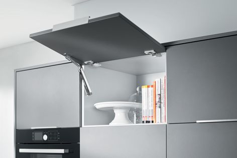 AVENTOS makes use of small storage spaces often found above the fridge or wall oven.