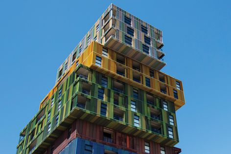"The ""Lego tower"" is clad in brightly coloured expanded metal mesh."