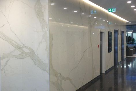 """Projects featuring Maximum Marmi """"Calacatta"""" include a vein-matched commercial lift lobby in this Queensland project."""
