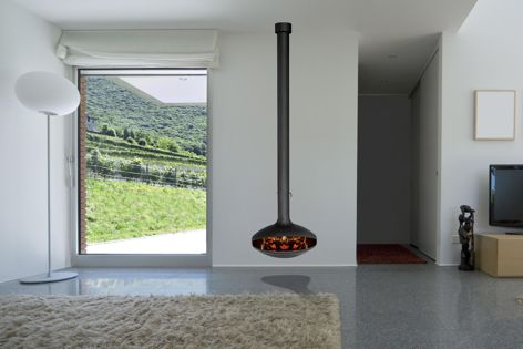 Free-hanging fireplaces from Aurora Wood Fires not only warm interiors, they also serve as design focal points.