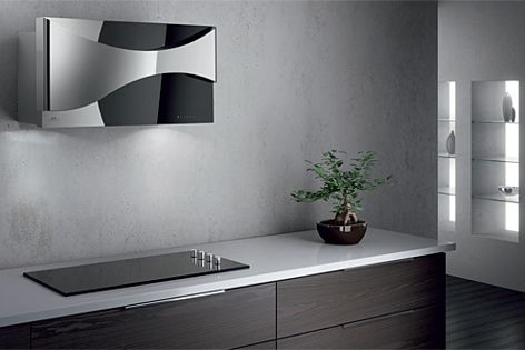 The Ambient Canopy rangehood is finished in stainless steel and gloss black.