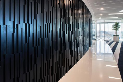 A dramatic backdrop created with Stack Panel feature panelling in black Japan stained cedar.