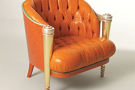 Colombostile's Capitonnè chair in orange ostrich leather.