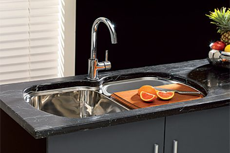 An optional kit for the Milan double undermount sink includes a chopping board and colander.