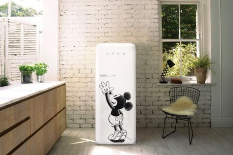 Smeg's FAB28 refrigerator has been adorned with a drawing of Mickey Mouse reaching for its handle.