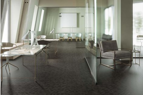 An office featuring Infused luxury vinyl planks in the Broad Street pattern option.