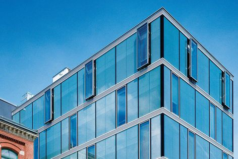 The units are integrated seamlessly into the facade of this office building in Esslingen, Germany.