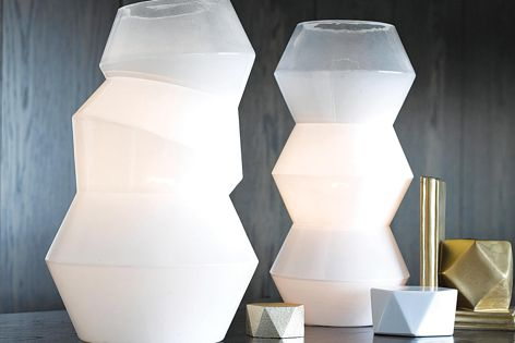 The Deka (left) and Facet (right) table lamps feature beautiful geometric shapes and are part of Beacon Lighting's Winter collection.