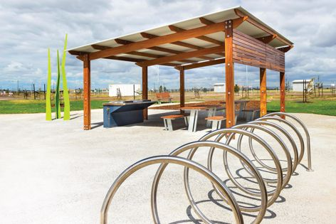 The Town and Park timber skillion shelter provides cover for a barbecue and picnic seating.