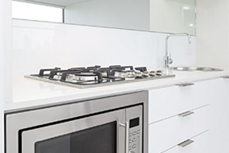 A Häfele rangehood, gas cooktop, convection oven, Round Bowl sink & Rectangle Gooseneck tap.