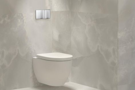 Geberit's Sigma60 button sits flush with the wall, making a subtle impact in contemporary bathrooms.