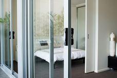 Altitude apartment sliding door
