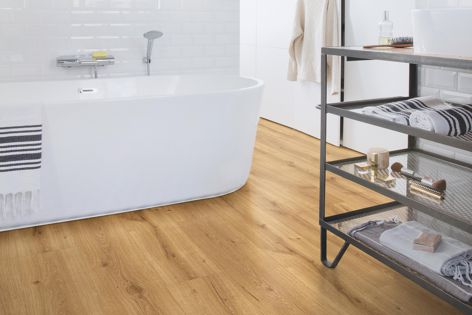 Majestic laminate flooring, pictured in 'Desert Oak Warm Natural,' offers the warm feel of wood.