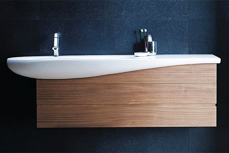 The 1600 mm washbasin features a wave shape that laps over the furniture element.