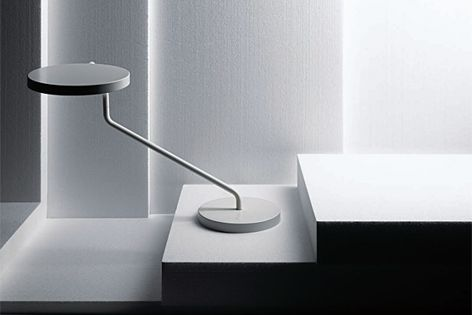 This desk light, available from Euroluce, features a head which can rotate 360 degrees.