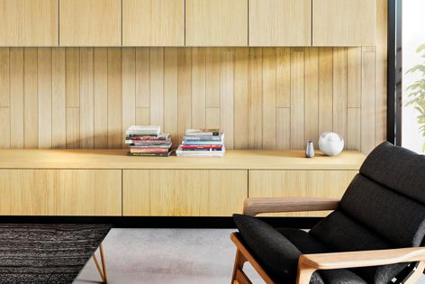 Sophisticated lounge cabinetry showcasing Laminex Finished Natural Timber Veneers in American Oak, with the kicker in Laminex Colour Palette Black.