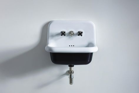 The Water Monopoly's Rockwell wall-hung basin in 'Ink Black Gloss' from The English Tapware Company.