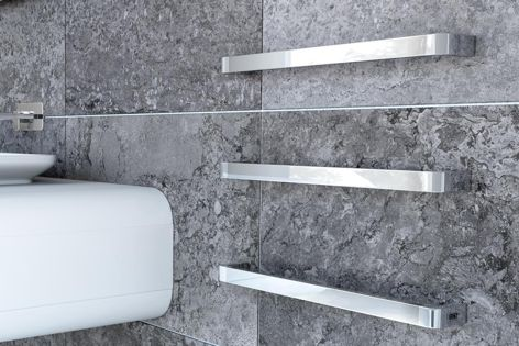 Available in a range of finishes, DC Short's heated Curvestone Modular towel rails are an ideal addition to bathrooms with a minimalist aesthetic.