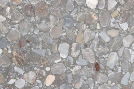 Fibonacci Stone's Allure terrazzo tiles feature a warm cement base interspersed with subtle silver, brown and cream tones.