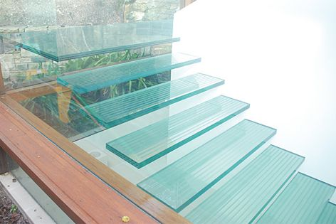 Structural laminated glass manufactured by Bent and Curved Glass was used to create this stair.
