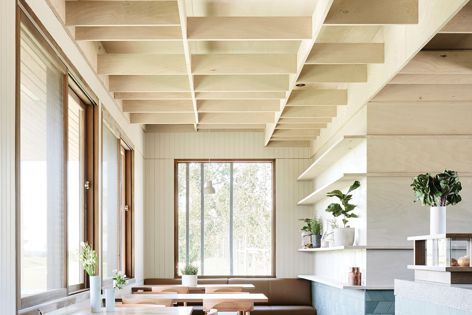 The Brompton Cafe has a light-stained plywood baffle ceiling. Architect: Craig Tan Architects. Photography: Eve Wilson.