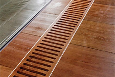 Trench convectors are built into the floor and covered with an elegant grille.