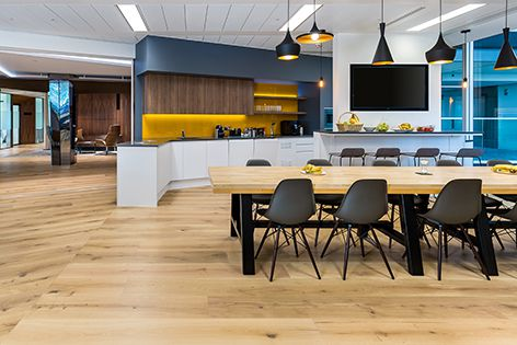 Amendo wide planks, from Havwoods' Venture Plank flooring range, were specified for this project at Amber Infrastructure in the UK. Designer: Paul Dare. Photography: Olivia Pohlmann.