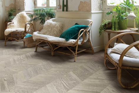 Quick-Step's Intenso range offers a timeless chevron design with easy-click installation.