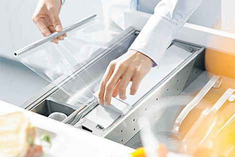 Orga-Line film and foil dispenser provides unobtrusive organization, making kitchen tasks easier.