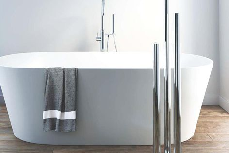 Truego Vertical is a luxurious floor-mounted heated towel rail, ideal for minimalist decor.