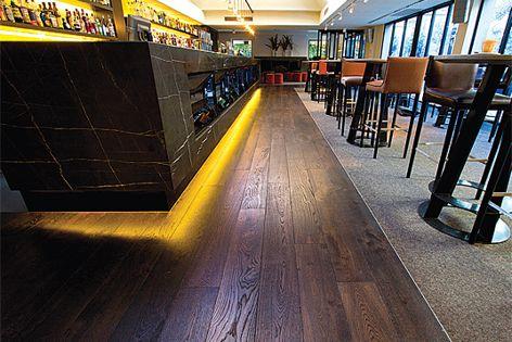 Tectonic flooring – heat resistance, moisture resistance and sound reducing properties.