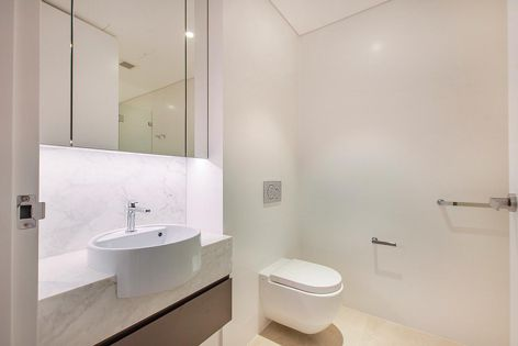 The Astonia Residences at Milsons Point feature signature-look bathrooms using Geberit's elegant Sigma01 button designs and finishes. Architect: Nettletontribe.